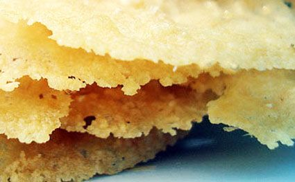 Parmesan Crisps. Make flattened piles of grated parmesan (1 tablespoon ...