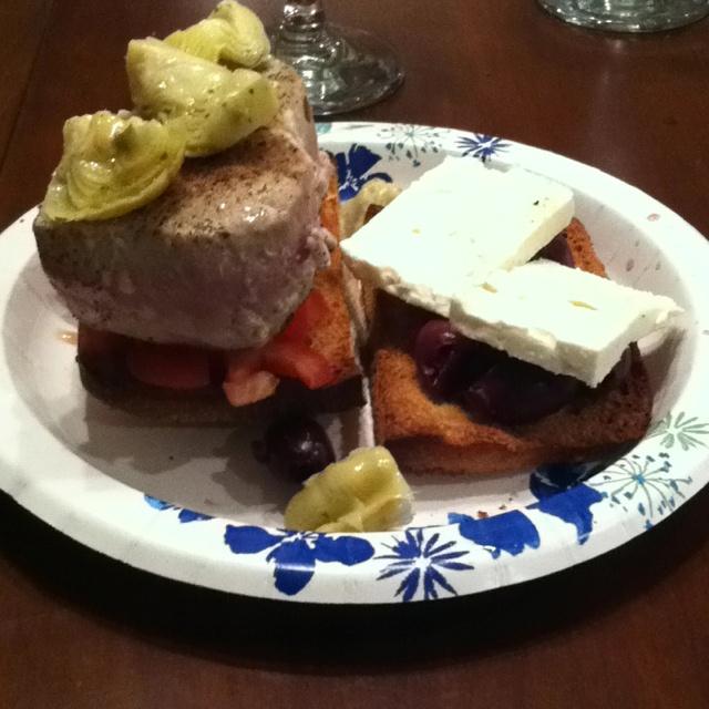 sandwich with feta slices, kalamata olives, Roma tomatoes, artichoke ...