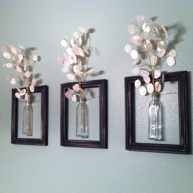 DIY Hanging picture frame vases.   Frames. Wire. Vases. Pretty easy to make!