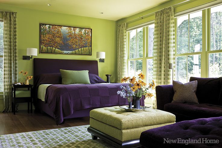 The master bedroom is a passionate blend of the couple's wedding colors of aubergine and hydrangea.