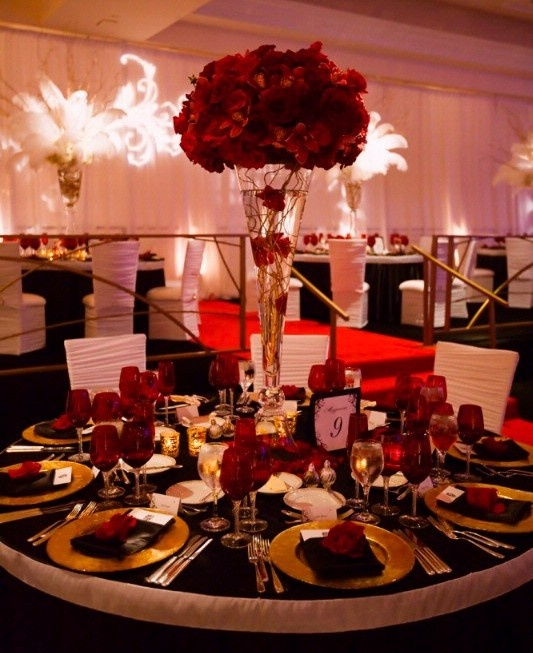 This dramatic wedding reception is perfect for the bride who loves all things glam! #redweddings