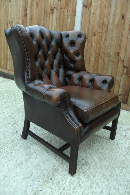Vintage chesterfield wing chair in antique brown leather delivery av