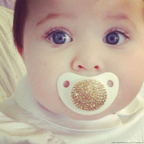 How adorable is this stylish gold-accented pacifier? Plus this looks like a baby Meghann! So adorable in every aspect!