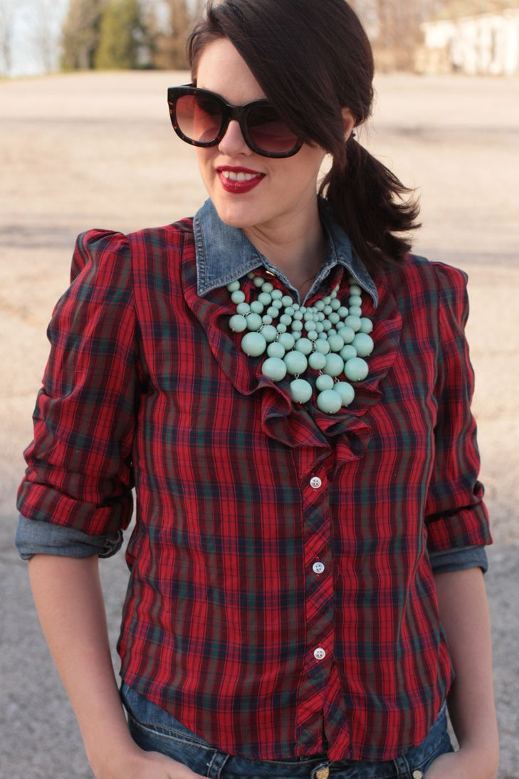 Plaid shirt over a denim shirt with turquoise necklace