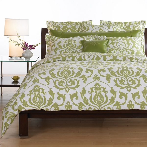 pretty green damask bedding would like this in a red or brown