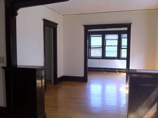 Dark Wood Floors with White Trim 539 x 403