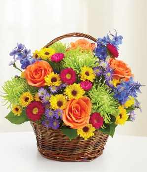 just buy about 4 bouquets at the grocery store & put them in a vase & then stick the whole thing in the basket...love this.