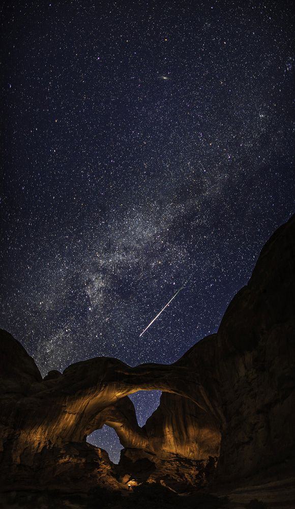 Double Arch with a Perseid Meteor and the Milky Way by Thomas O'Brien. A meteor captured streaking across the sky above Arches National Park, Utah, during the annual Perseid meteor shower. The Perseids is one of the most prolific showers, often with around 80 meteors an hour during its peak. Nevertheless, meteors are hard to catch on camera. The photographer has used an artificial light source to illuminate and emphasise the dramatic rock formations.