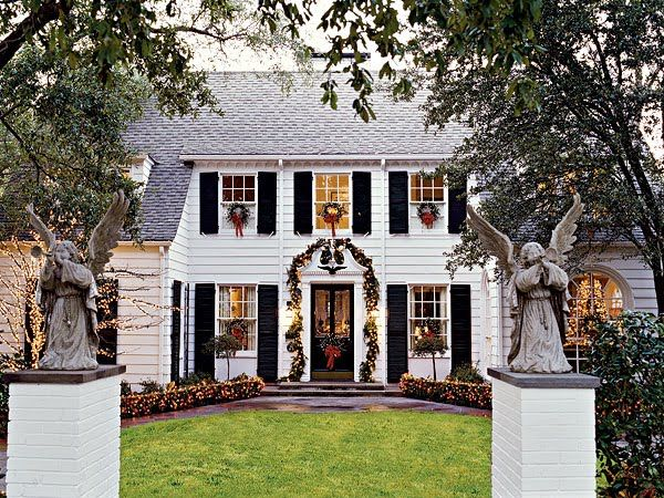 I want my house to look just like this for Christmas.  Wreaths in windows and garland around door.