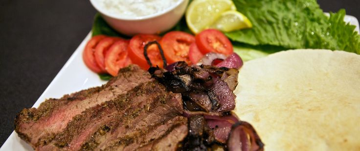 ... Flank Steak Pita Sandwiches - grilled red onions, tzatziki, tomato and