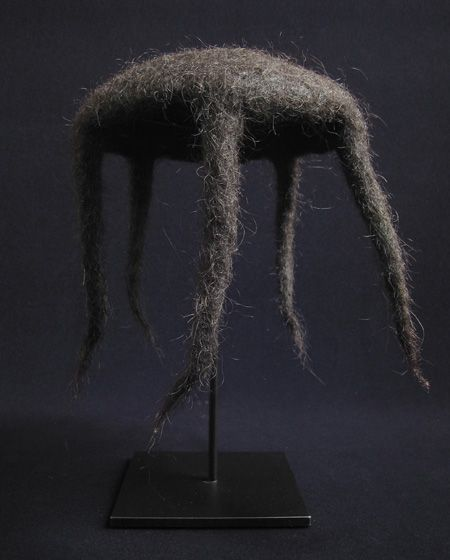 RAiN HAT from Bhutan, yak hair. The pointed ends would stream the rain away from the wearer's body. Mid- 20th century.