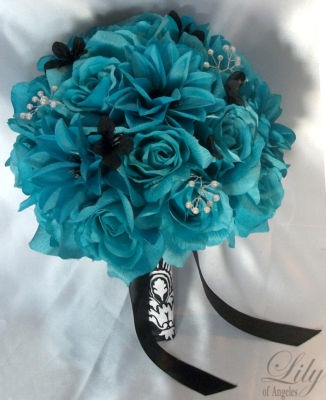 calla lilies with a little bit of teal flower wrapped in damask wrap....yes that would be awesome