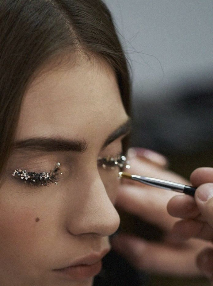 Glitter lashes backstage at Chanel
