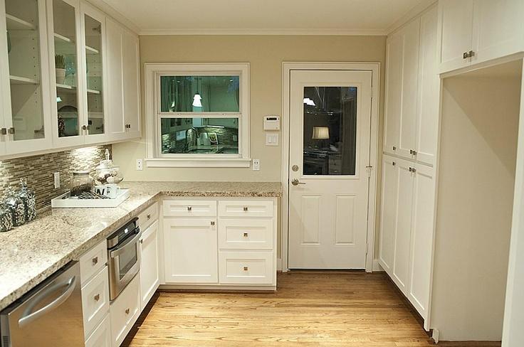 kitchen White cabinets, white wood trim, wood floor, kitchen