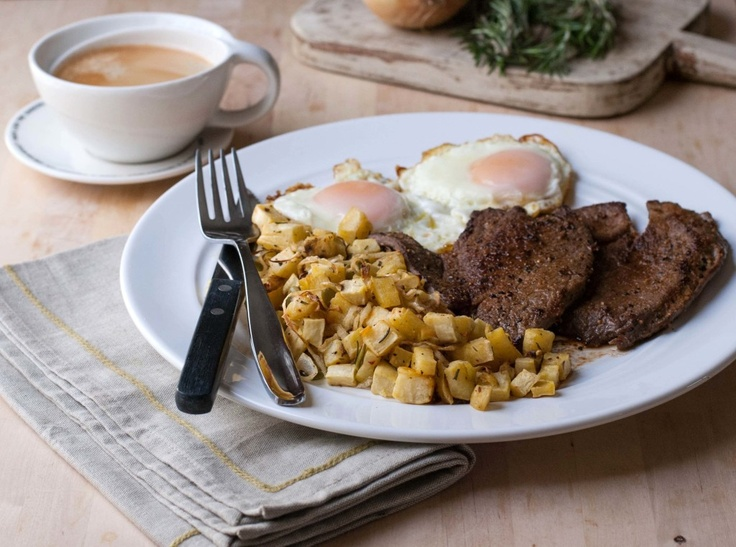 Steak and eggs with a rosemary sweet potato hash.