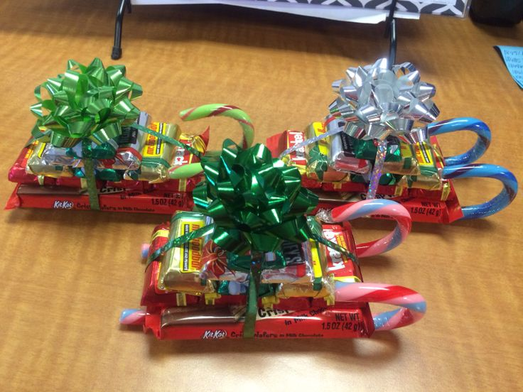 Candy sleigh. 1 kit kat, 10 mini candy bars and 2 candy canes.