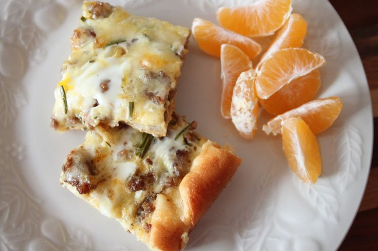 Breakfast Casserole 1/2 –1lb cooked ground sausage 1 pkg crescent rolls  1 c shredded cheddar cheese 5 eggs  1/4c milk 1 T oregano or rosemary 1/2t salt 1/4 t pepperPreheat 400*  Unroll crescent rolls, spread out in bottom of 9×13pan pressing seams together  Spread cooked sausage over dough  Sprinkle cheese on top, whisk the eggs with milk & spice, salt, and pepper Pour egg mixture over top Bake 15-20 minutes until crust golden & eggs set
