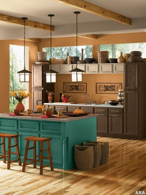 the fact that it is a kitchen  and the color scheme is beautiful