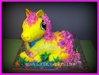 My daughter wants a My Lil pony cake. This cake looks a little to ...