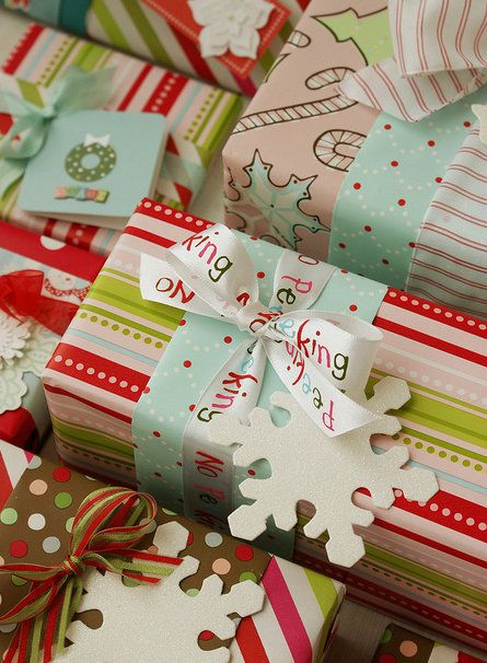 100 Days of Christmas!  Day 65-Consider using you leftover scraps of wrapping paper as an accent for other gifts. Two coordinating papers plus a little bit of ribbon makes for an eye-popping gift!