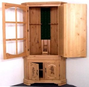 Hidden corner gun cabinet