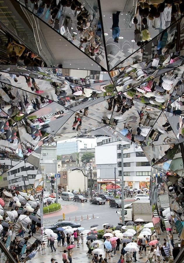 Mirrored entrance to the Omohara Plaza in Tokyo by architect Hiroshi Nakamura.