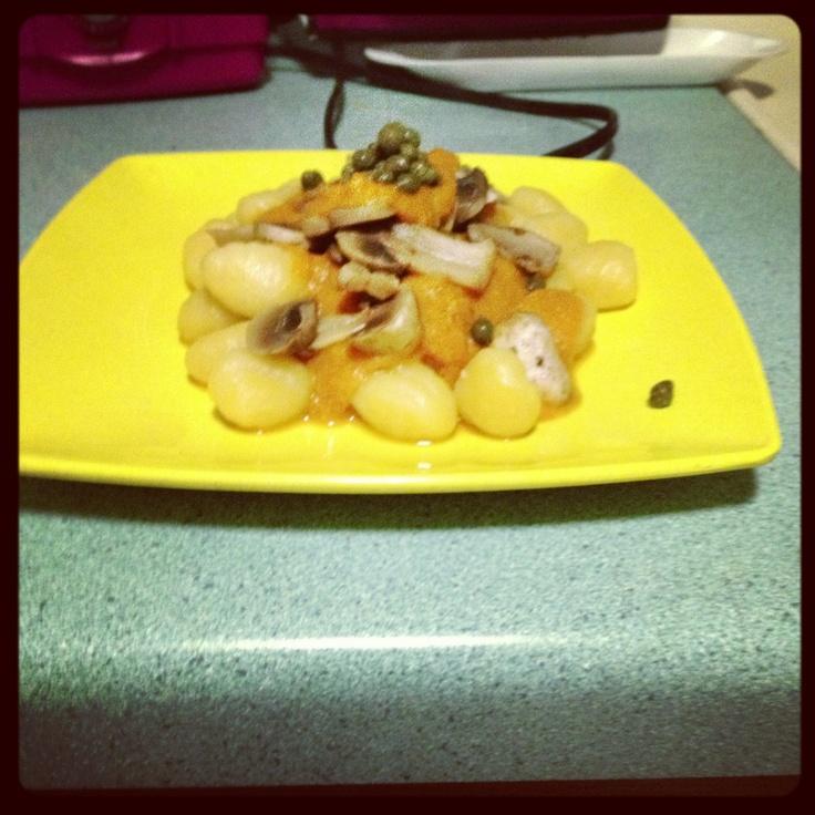 Pumpkin gnocchi with a pumpkin sauce, sautéed mushrooms, and capers