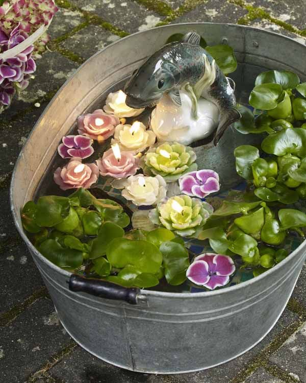 decorating floating candles- A secret wishing well can be designed quickly as one of your wedding decorating ideas.