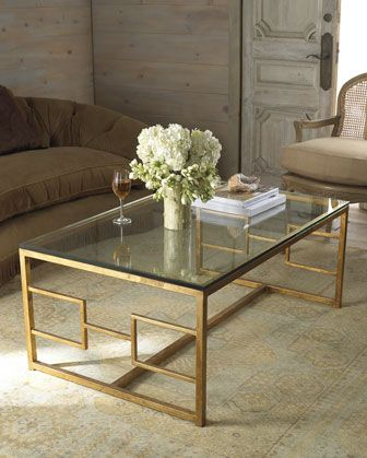 Hand-wrought iron coffee table with gold-leaf finish at Horchow...I LOVE Glass tables, the light shines thru & reflects off them - Classic!