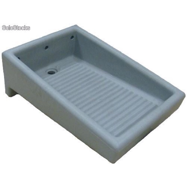 ... the houses in the colonia had a built-in washboard in the patio sink