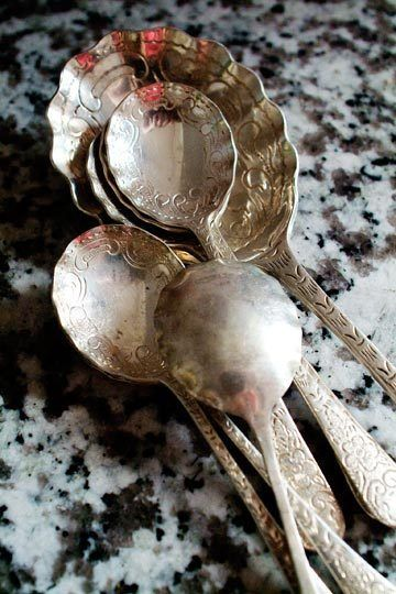 Polish your silver naturally!  1. Put water, 1 TBSP baking soda and aluminium foil (shiny side up) into a saucepan.  2. Bring to the boil.  3. Place your silverware into the saucepan, only a couple of pieces at a time. This should only take about 10 seconds but if they are really tarnished they may need a bit longer.  4. Use your tongs to fish out your silverware and marvel at how shiny it is!  5.  Buff dry with a dry cloth.
