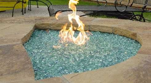 poolside gas firepit with firebed of colored glass crystals