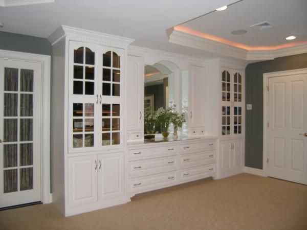 bedroom built in unit floor to ceiling cabinets with different
