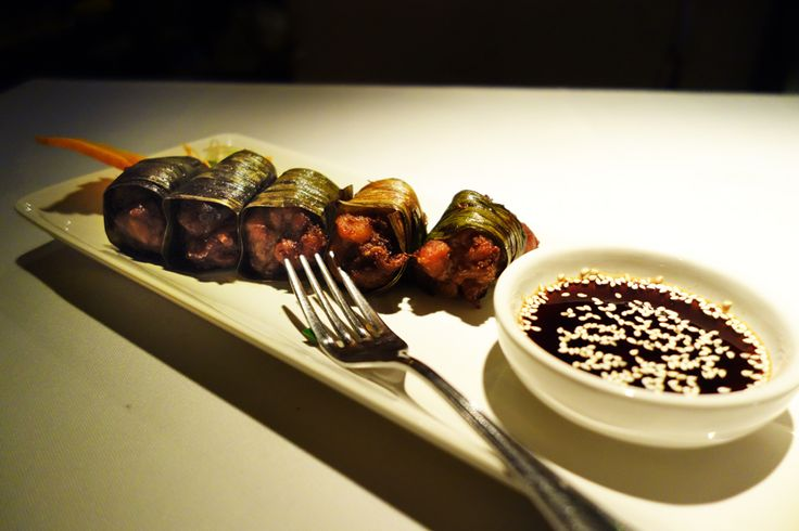Asian Food / Thai style deep fried chicken wrapped in pandan leaves ...