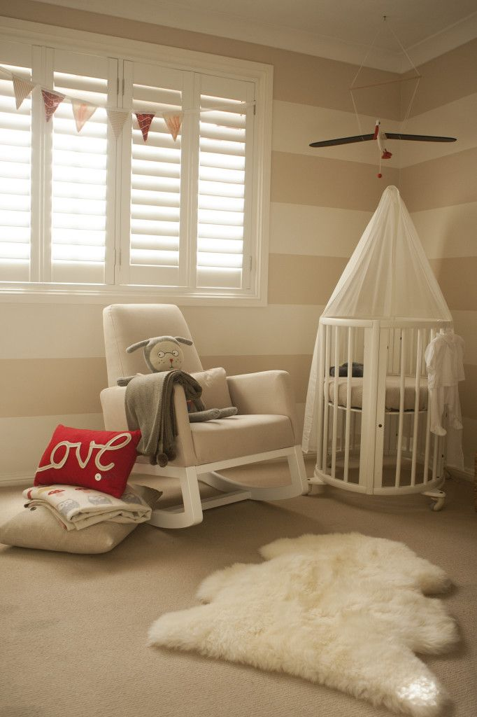 Gender Neutral Nursery - we love the added texture of the rug and crib canopy and the pops of red! #genderneutral #babyroom