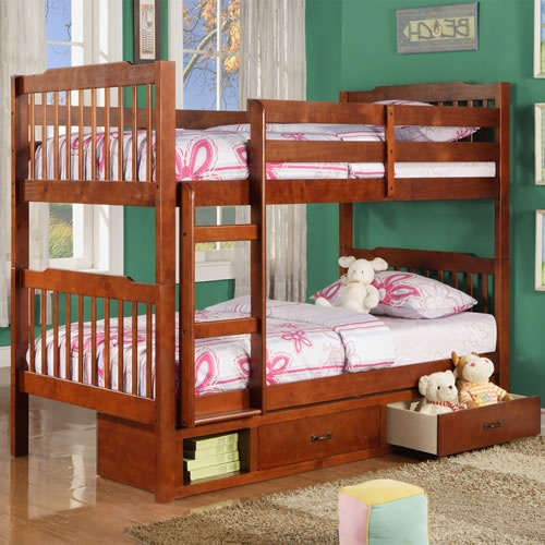 This mahogany finish bunk bed features two useful storage drawers and a small cubby underneath the bottom bunk. A built in ladder and safety guard rail help keep the occupant of the upper bunk safe, and attractive slatted head and footboards make this bunk bed the ideal choice for any child's bedroom.
