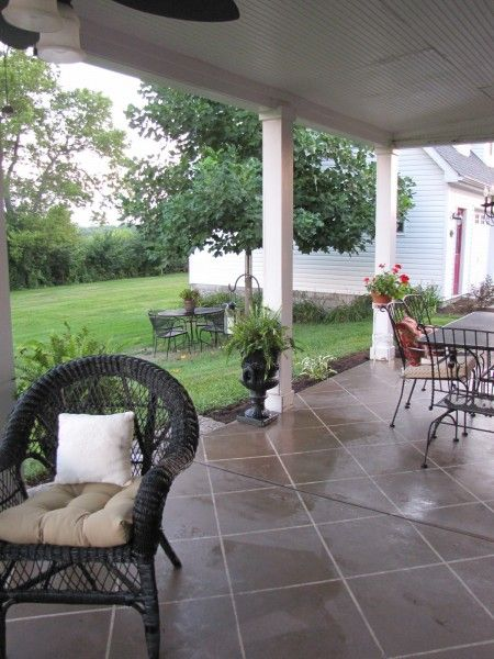 Painted concrete patio floor. DYI instructions.  Love the curtain idea!  We may just do that for 2 reasons.  To protect our furniture from fading and to block the wind a little.