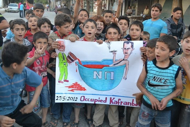 Syria's Children. A group of boys posed with an anti-regime sign in Kfar Nubul on May 27, in this photo released by an opposition group.