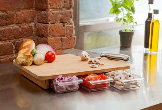 A Cutting Board With Built In Storage Containers