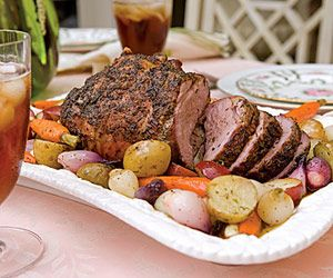 Roasted leg of lamb with lemon and herb vegetables
