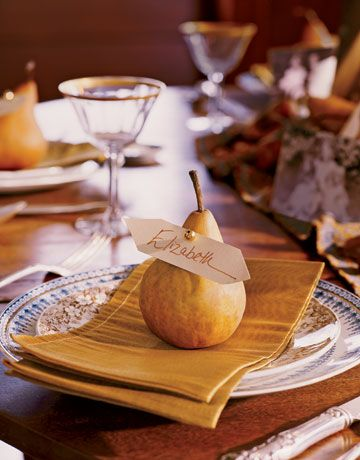 This year, prepare a memorable table using everyday materials and your favorite things. A simple pear becomes a placecard for dinner guests.