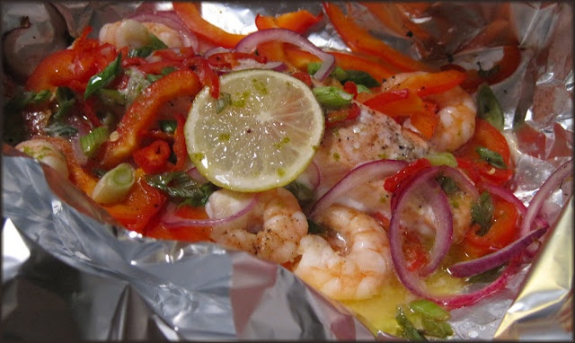 Foil-Baked Salmon and King Prawns with Chili and Lime Butter