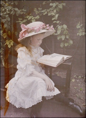 1908 girl reading a book
