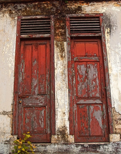 flaking red doors