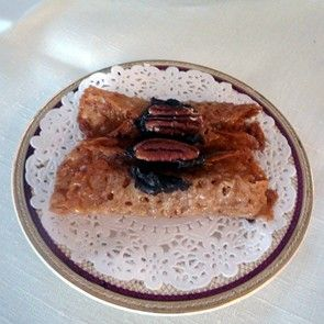 French Lace Cookie Rolls with Chocolate and Pecan Garnish