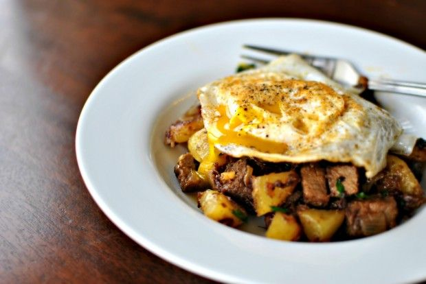 Fried eggs over breakfast hash - made this with steak instead of prime ...