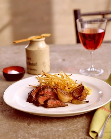 ... hanger steak with shallots, matchstick fries and creme caramel for