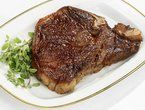 Grilled Pepper Crusted T-Bone Steaks with Worcestershire-Chive Butter