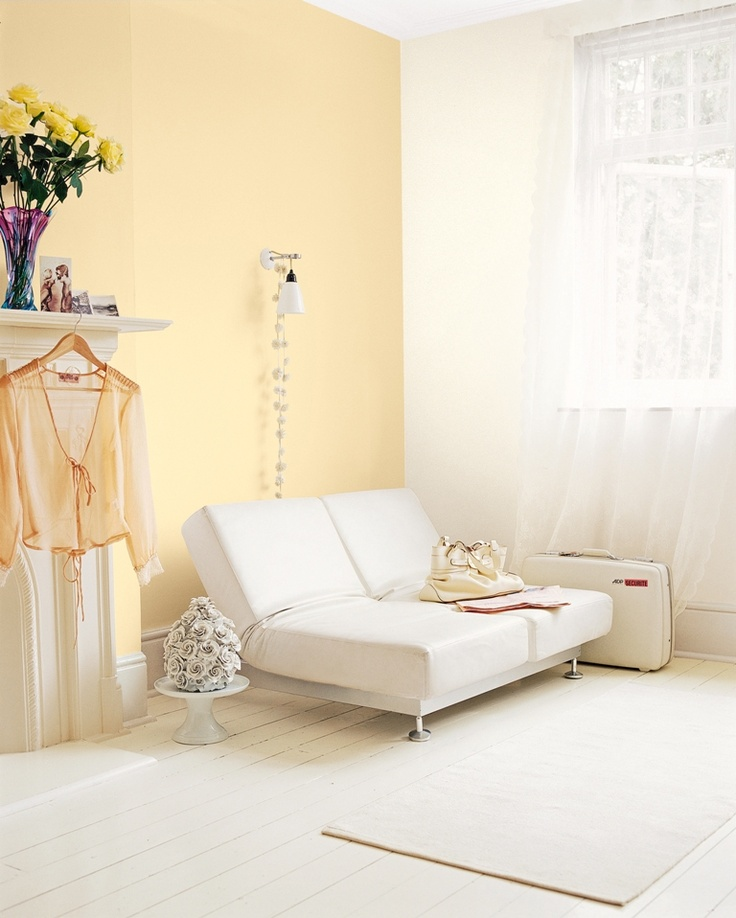 Pale Yellow And White Bedroom Painted With Crown