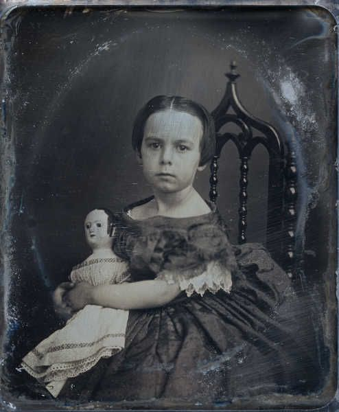 Antique dagurreotype, circa 1856, of Mary Ella Jenks (born in Pawtucket, RI, in 1850), holding her Izannah Walker doll. Ms. Walker, one of America's earliest female doll makers, lived in the same town and was friends with the Jenks family. Follow link for the full story from the owner of this striking daguerrotype.